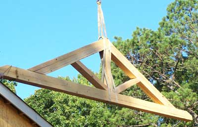 Antique Heart Pine Truss being lifted into place on house in Columbus, MS