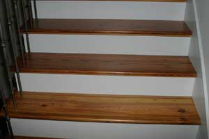 Antique Heart Pine Stair Treads with bullnosing and left hand return